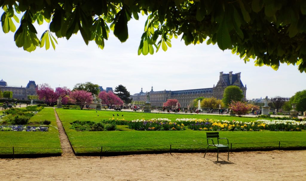 View of the Louvre Museum from the Tuileries Gardens in Paris.